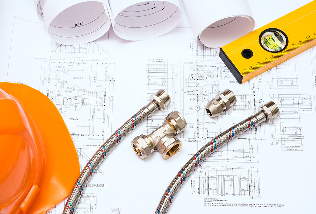 blueprints, spirit level and gas fast tools