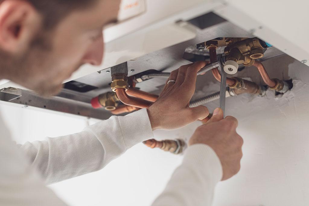 gas fast engineer repairing boiler